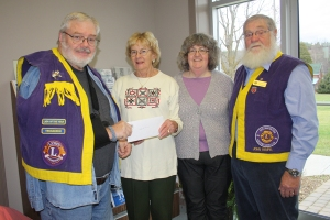 Ruth Pedherney, left, and Pam Stuffles of the Westport Public Library receive a cheque on behalf of the library.
