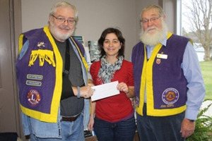 Westport Lions Club Treasurer, Bob Weir, right hands a donation cheque to Leslie Renwick, of Community and Primary Health Care, along with Lion President, John Rempel. It was one of six donations totalling $2150 presented by the club last week. The others are below. The Club also donated funds to Dog Guides, Canadian Diabetes Association, Effective Speaking, Camp Kirk, Children�s Wish Foundation, and Rideau Sewing Club.