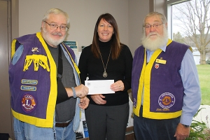 Rideau Vista Public School Principal, Teresa Polite, accepts a cheque for her school from the Lions Club.