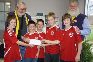 Portland Football Club members receive the cheque for their team. (L-R) Wesley Ewart, Cameron Scott, Brady Scott, Evan Rice, and Will Ewart.