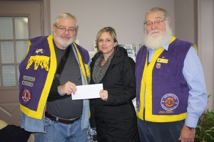 Niki Bresee receives a cheque for the North Leeds Minor Hockey Association.