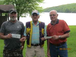 Lion Don Baker, Chairperson of the Westport Lions Spring Cash Draw presented first prize $1500 to Harry Beckett and third prize $250 to Bernie MacLean, both of Westport and second prize $500 to Edward James of Ottawa who was not available.